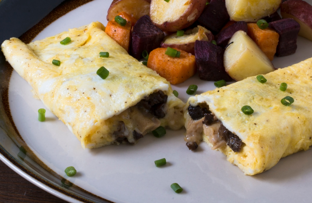 Chicken neck meat, morel, and cheddar cheese omelet with duck fat roasted mixed potatoes hr-9846-2