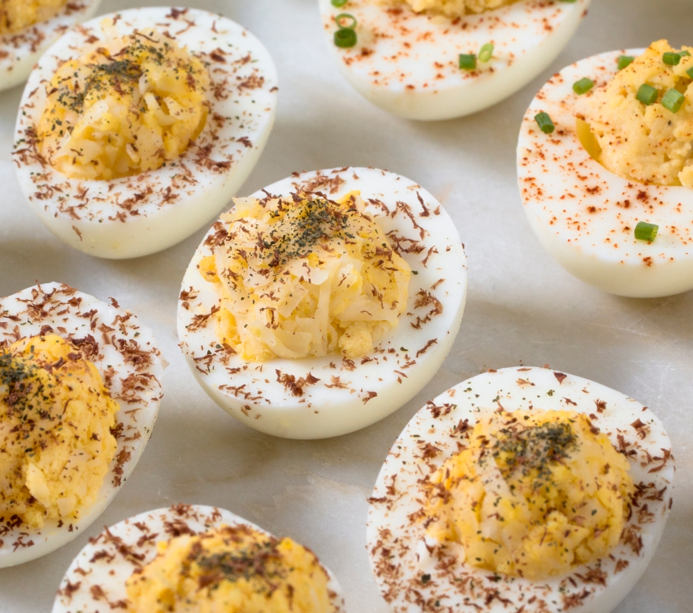 Deviled eggs with Gruyere, dark chocolate, and shiso powder hr-9616