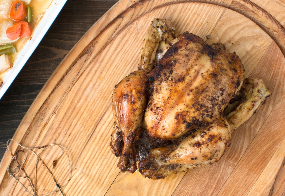 Dried lemon and pepper roast chicken on the cutting board hr-9244