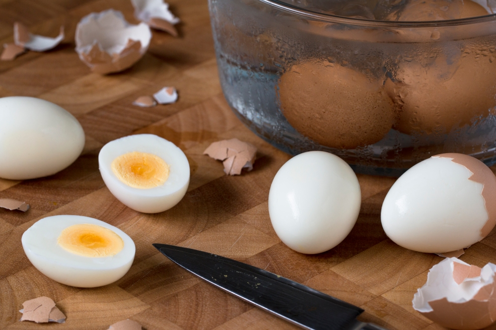 Prep for deviled eggs with Gruyere, dark chocolate, and shiso powder hr-9555