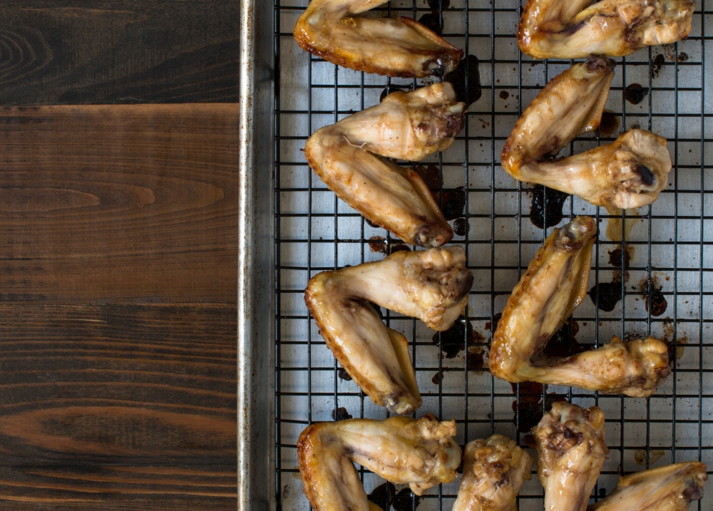 Soy sauce and honey roasted chicken wings out of the oven hr-9868